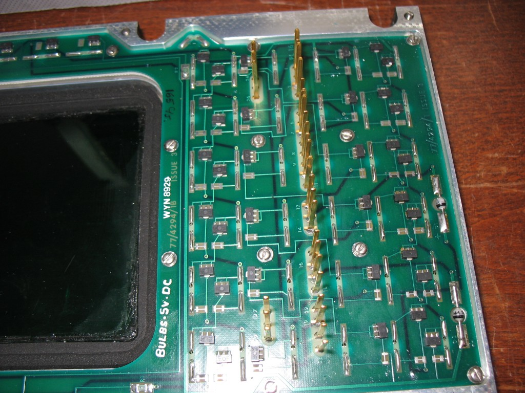 Teflon sheet peeled back showing PCB