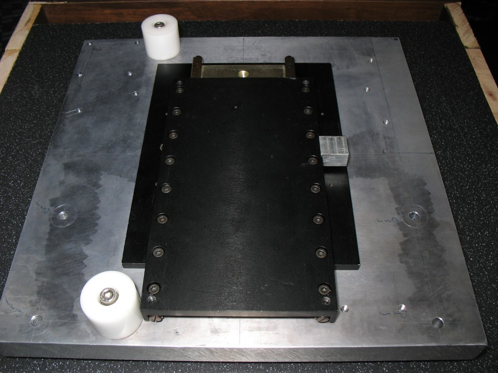 Linear bearing for the Y axis and belt bearings mounted on the base plate.