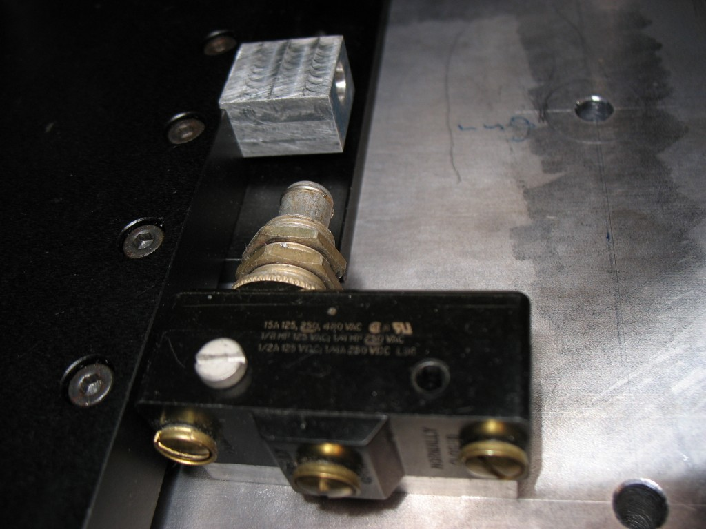 Y axis limit switch mounted on base plate